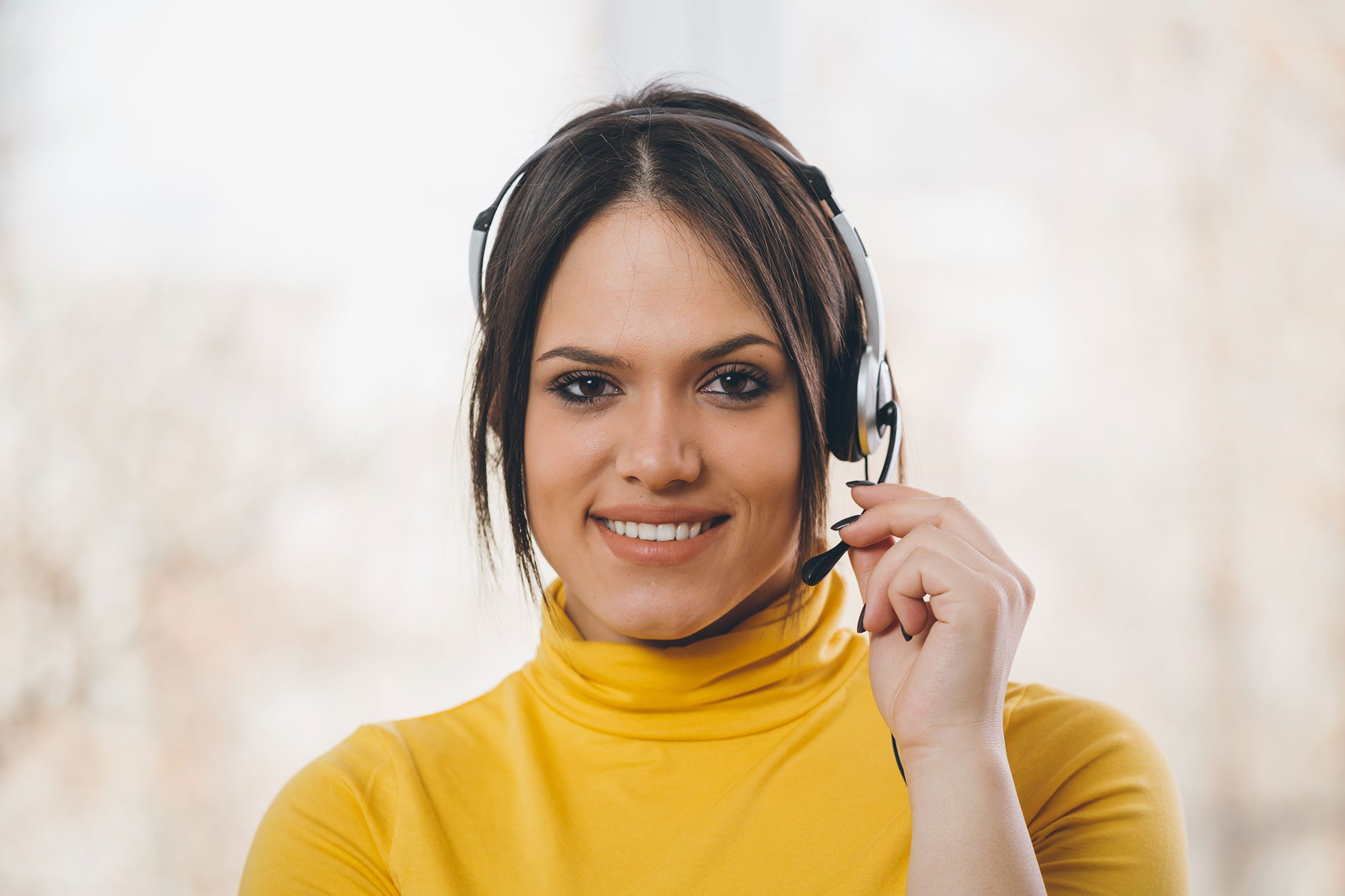 woman customer support with headphones