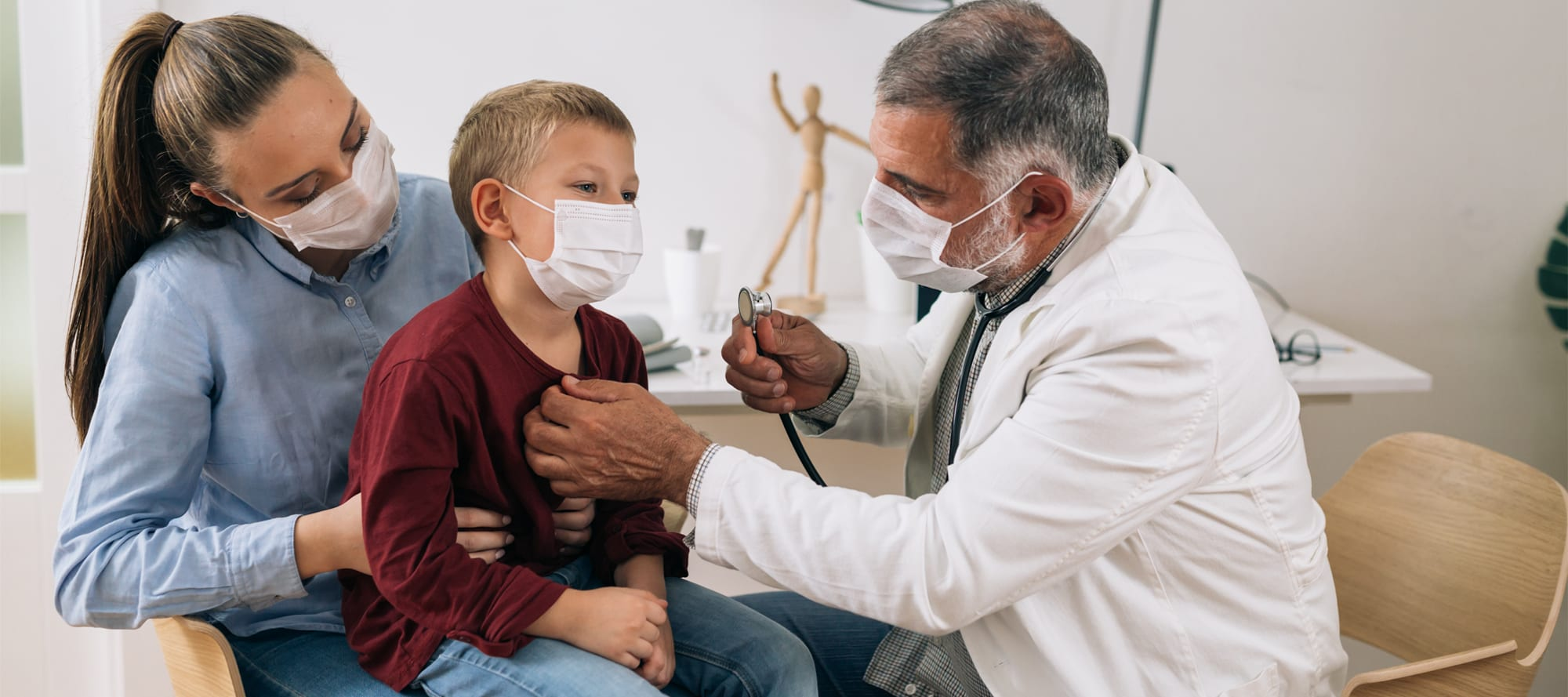 Doctor evaluating health of child