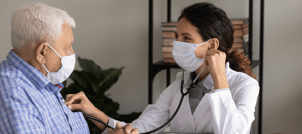 Doctor checking a patients lungs